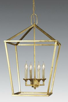 Cast brass four light lantern. Shown in french gold with patina finish. Available in other custom finishes.