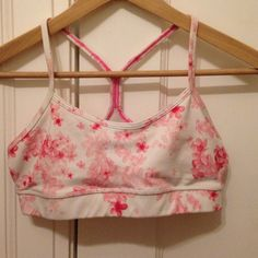 Cherry blossom lululemon power y sports bra This is the power y/flow y bra. It's practically new, just too small for me!! So adorable, I really wish it fit. I love the pink flowers! Lululemon has great sports bras. This one is very rare!! lululemon athletica Intimates & Sleepwear Bras