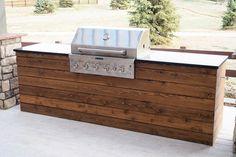 Built in Grill Cedar planks - Black granite - Kitchen aid built in grill - outdoor tile - wood tile - patio - outdoor living space #updateoutdoorlivingspace