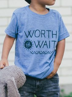 Aztec inspired word mark printed on American Apparel's Tri-blend Kids Tee.  Tri-Blend (50% Polyester / 25% Cotton / 25% Rayon) construction.