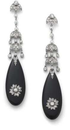 Each designed as an onyx drop with applied circular-cut diamond foliate motif suspended from a seed pearl and similarly cut diamond foliate drop and surmount, length 6.5 cm.
