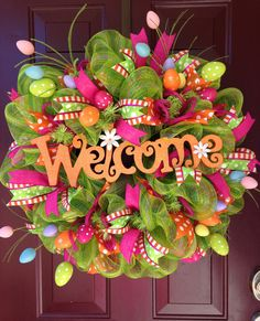 This deco mesh wreath incorporates green mesh, hot pink tubing, 3 colorful ribbons, Easter Eggs sprays, topped off with a bright orange welcome sign. This is certain to liven up any front door! Wreath Crafts, Diy Wreath, Wreath Ideas, Wreath Making, Holiday Wreaths, Holiday Crafts, Easter Wreaths Diy, Diy Ostern, Summer Wreath