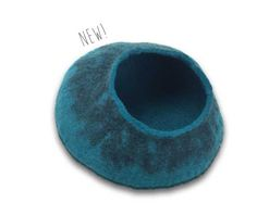 Shop unique pet products at Team Pet Supply where every purchase helps shelter pets! Walking Palm Cat Cave Turquoise/Black - from $38.95.