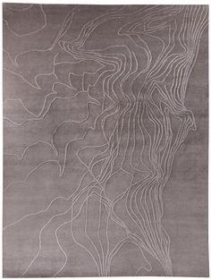 A collaboration between creative minds Joseph Carini and Karl Klingbiel, Topop's appeal is it's subtle texture and elegant composition. On a field of rich wool, wavy lines of silk create abstract shapes and designs