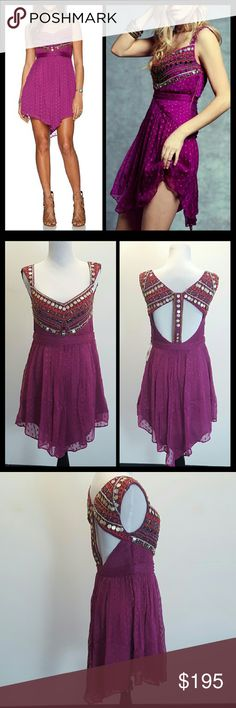Free People Jeweled Cheveron mini dress Like new, worn once. Still have the original tags. Crinkly Swiss dot mini dress featuring a beautifully vibrant neckline of beads and charms. Open back with cutout detailing. Hidden side zipper. 100% Viscose Free People Dresses