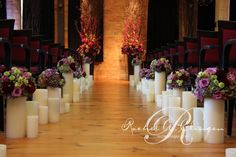 pretty aisle lined with luminaries and flowers
