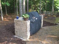 """Building an grill surround and more! - posted in Custom Outdoor Kitchens: Have my new s330 up and grilling and want to build an island or surround for it and my OTG and my 3 WSM (bring the whole family together). Basically want to build a surround for the s330 and a wall for the rest, kind of in a """"T"""" shape. The wall would be for looks, shelter and for a wind break. Reading through all the posts, venting comes to mind. What kind of venting does it need? There are designs o..."""