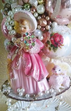 SOLD - Custom Orders Welcome! This is a one of a kind handmade creation by artist Caroline Sherman of Laughter and Lemondrops. It is a Shabby Chic Rose Themed Bottle Brush Tree with a Made in Japan Girl Figurine. She has a Pink Spaghetti Poodle next to her. This tree is packed