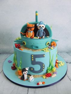 This fully edible white chocolate mud cake is based on the octonauts theme. I was going to use rice crispies for the submarine, but ended up carving another small cake instead. I'm quite happy with how it turned out!