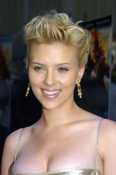 Scarlett Johansson Has Tried Just About Every Hairstyle in the Book  - March 31, 2017:  Back to blonde, Johansson wore her hair in a tousled up do with luminous skin and satin pink lip at the New York film premiere of The Island in 2002.