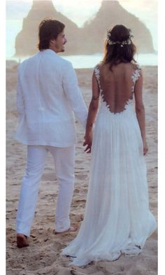 Gorgeous wedding dress.  Not that into the white suit though.