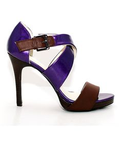 Hit+the+street+in+high+style+in+a+super-dressy+pump+that's+meant+to+be+seen.+The+metallic+straps+give+an+uptown+sophistication+to+this+high-heeled+lovely.+Show+off+a+pretty+pedicure+from+the+open-toe+front.