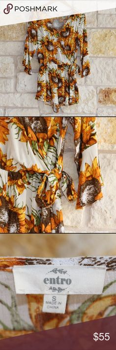 """Sunflower Print Wrap Romper NWOT •bought to wear for my graduation party but unfortunately its too shorts for me •it has 3/4 sleeves with a bit of a bell flare and the shorts have a little ruffle as well •tie front and it has a button closure for a more modest look or you can undo it for a deep-V •I recommend this for shorter girls—I'm 5'7"""" and its just shorter than I prefer (from shoulder to bottom ruffle it measures 28.5"""")  Let me know if you have any questions :) entro Dresses"""