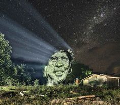 Members of a Brazilian Indigenous Tribe Projected Onto the Amazon Rainforest by Photographer Philippe Echaroux