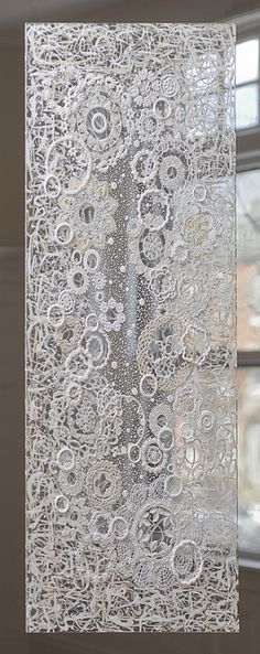 A modern take on the lace curtain - try a random net base with crocheted, appliqués and cutout pieces. Great use for recycling those old and new ends or bits of lace. Reminds me of a Vctorian crazy quilt idea..
