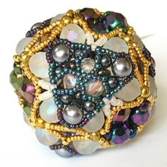 Gwen creates the most awesome beaded beads (this one's a paperweight, but doesn't it look like a giant bead?)  :-)  @Gwen Fisher #gwenbeads
