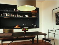 """Appliances, counter and open shelves are neatly contained in a chic black box. --from """"The Right Color"""" by Eve Ashcraft"""