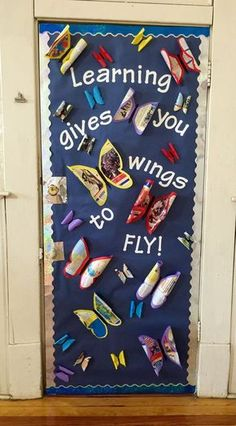 "Back to School bulletin board or door idea! ""Wings to Fly!"" Wings are butcher paper and old textbook pages."