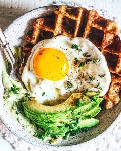 Oatmeal, but make it savory. And waffled, and cheesy ... and egg-topped! Oh and what the heck, go ahead and throw some sliced avo and an herby yogurt on there, too. 😆 Have you ever tried savory oatmeal before? I think I prefer it, tbh. #waffles #oatmeal #savorywaffles #avocado