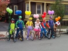 Birthday party for mik. Just ask people to bring a bike and have costumes ready then pin balloons when their not looking