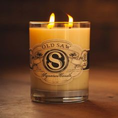 The OLD SAW Signature Candle smells like cedarwood, tobacco flower, brown sugar and whiskey. Basically heaven. It is hand poured in Tennessee and burns for an approximate 80 hours. When the wax is all gone, simply peel the label off and use the double old fashioned glass to sip your favorite beverage from.