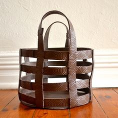 Make a simple, bold statement with this DIY leather basket. Includes an easy to follow step-by-step tutorial