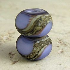 BEAUTIFUL BEADS!!!    Purple Lampwork Glass Bead Pair with Organic Swirls and a Frosted Etched Matte Finish Small 11x7mm Amethyst Velvet. $5.80, via Etsy.