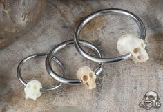 Titanium captives with fossilized mammoth skull beads