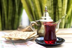 turkish tea in red glass cup with turkish food by nebia side larbi - Photo 239951081 / 500px
