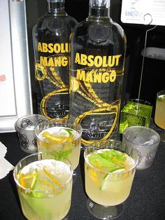 Mango mojito - Absolut Mango 2 oz. simple syrup 1 oz. lime juice 2. oz. Mint muddled with lemon peel.  Splash of sprite. Cool