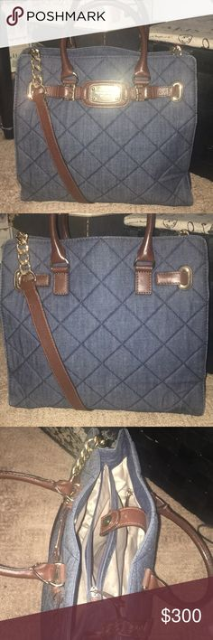 Michael kors denim hamilton 💙 Good loved condition. Denim has no stains or marks. Leather strap and handles have a few nicks on the leather. Nothing serious or crazy obvious. Can be worn as a shoulder bag or you can adjust long strap to bag to stay in place. Inside is a little worn. Multiple pockets for organization. Zipper pocket has a lipstick stain. This purse is large sized. Can fit a smaller laptop or iPad. Inbox with questions. Need to let this beauty go to a good home 😍 Michael Kors…
