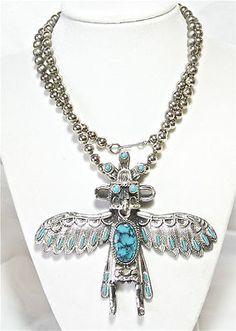 VINTAGE HOPI KACHINA SILVERTONE FAUX TURQUOISE NECKLACE SOUTHWEST JEWELRY RARE    Seller information  justinsublime (1665  )    99.9%Positive feedback  Save this seller  See other items     AdChoice  Item condition:Pre-owned  Time left: 6d 21h (Mar 28, 2013 17:36:27 PDT)  Starting bid:US $17.77  [0 bids ]