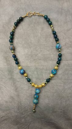 Check out this item in my Etsy shop https://www.etsy.com/listing/206083357/imperial-jasper-aqua-necklace