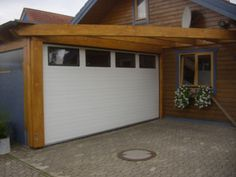 Garagentor mit tür modern  Double wide carports with roller door | DMV Outdoor Solutions www ...