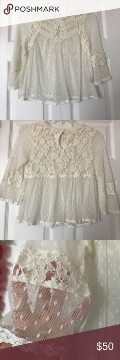 Free People Blouse Cream colored Free People Blouse with sheer material; crochet & knot detailing throughout; beautiful flower design throughout the shirt; excellent condition; Size: S Free People Tops Blouses