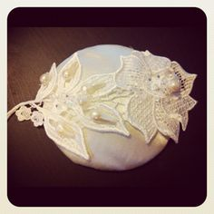 Top view of new satin and lace head piece now for its birdcage veil :D
