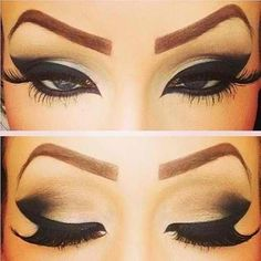Beautiful dramatic eye makeup.....though it would be much better if the brows were less cartoonish.