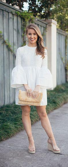the one white dress you need this spring    LonestarSouthern.com #whitedress #bellsleeve #strawbag #goldhoops