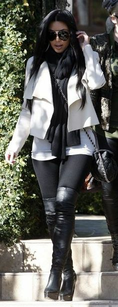 Who made Kim Kardashian's black leggings, purse, thigh high boots, sunglasses and jacket that she wore on December 31, 2010?Purse – Chanel  Shoes – Lanvin  Scarf – T by Alexander Wang  Sunglasses – Porsche  Pants – Lna  Jacket – Camilla And Marc