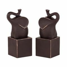 "Brown bookend with a trumpeting elephant silhouette.    Product: Set of 2 bookendsConstruction Material: ResinColor: BrownDimensions: 8.75"" H x 3.5"" W x 3.5"" D each"
