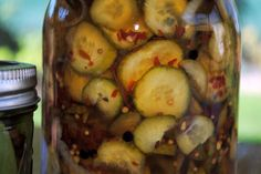spicy bread & butter pickles   ingredients: ½ cup vinegar ½-1 cup sugar (depending on how sweet you like yours..) ¼ cup kosher salt 1 tsp turmeric (all the recipes called for it I didn't have so I didn't use it) 1 tsp. celery seed i used about a ½ tblsp. of pickling spice 1 tblsp. of crushed red pepper and yes they are hot!! (so use less of you want or eliminate all together) 1 lb. small cucumbers, sliced *pickling cucumbers work best*  1 sweet onion, sliced