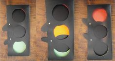 Traffic light prop. I made this out of a black plastic folder, because the material is sturdy enough. I cut two covers with handles slightly bigger than the holes. They look like paddles for table tennis. Glue coloured paper behind the holes and attach the handle of the covers inside the traffic light with butterfly pins.