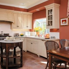 country kitchen paint colours table chairs flowers very earthy red walls round top island window wall cabinets painting mediterranean kitchen of Inspiring Country Kitchen Paint Colors to Get Inspirations From Two Tone Kitchen, Kitchen Redo, New Kitchen, Kitchen Remodel, Kitchen Cabinets, Round Kitchen, Cream Cabinets, Wall Cabinets, Kitchen Ideas