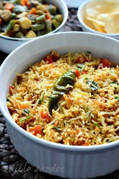 Tomato rice – a mild South Indian rice recipe with tomatoes, chillies, onions, and garlic. Tomato rice or thakkali sadam is probably a busy cook's best friend. If you have some cooked rice and ripe tomatoes ready, this one pot meal comes together in about Tomato Rice Recipe South Indian, Indian Food Recipes, Asian Recipes, South Indian Vegetarian Recipes, Veg Recipes Of India, Tandori Chicken, Arroz Frito, Biryani Recipe, Indian Dishes