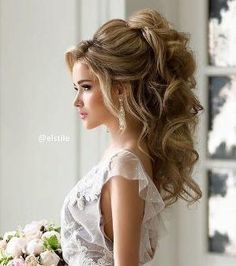 Wedding hairstyle idea; Featured Hairstyle: Elstile by Gloria Garcia