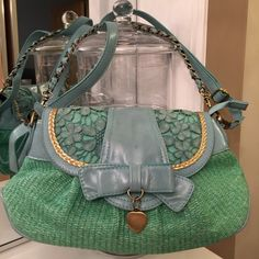Nicole Lee Bag Nicole Lee teal lace bag, w/minor damage 2 spots which may be removed, & chain material has wearing. ✨Potential customers✨Items are not in perfect condition however, we take care of items and find it discouraging when people try to finagle for unreasonable prices due to being a self seller, and items may not be a 100% perfect. If your expectations are items to be like within a store, please do not purchase. Any questions we will be glad to answer. Thank you for stopping by our…