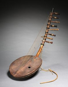 East Africa, Uganda, 20th century, wood and leather, Overall - h:66.70 cm (h:26 1/4 inches). Gift of the Gilpin Players of Karamu House 1929.322