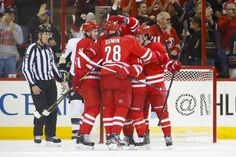 CrowdCam Hot Shot: Carolina Hurricanes left wing Nathan Gerbe is congratulated by teammates after his period goal against the Pittsburgh Penguins at PNC Center. Photo by James Guillory Carolina Hurricanes, Left Wing, Hot Shots, Pittsburgh Penguins, Hockey, Period, Goal, Field Hockey, Ice Hockey