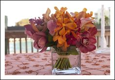 Tropical fall themed centerpieces by Love In Bloom Florist at Ocean Key Resort Key West