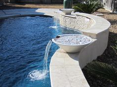 Swimming Pool Water Feature Photos The Woodlands, Houston & Katy Waterfalls, Bubblers & Slides Water Features can add dimension and elegance to your backyard swimming pool. Waterfalls, grot…